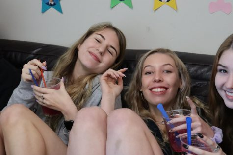 Maria Dobroskok, Emma Mann, and Liza Meyer on the couches in the Lounge.