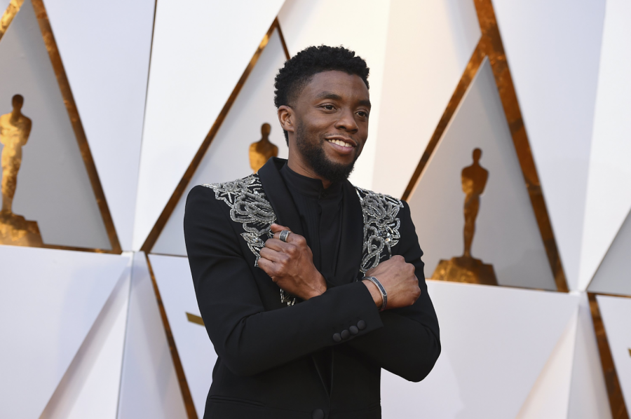 Chadwick Boseman  at the Oscars' doing the infamous 'Wakanda forever' pose from Black Panther