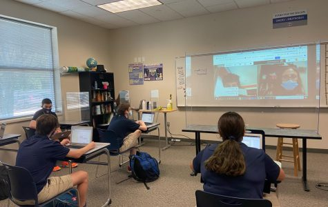 Ms. Rosenthal's upper school history class is working hard to include virtual students by projecting them onto the white board.