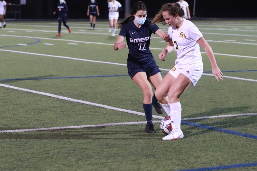 Varsity girls soccer player Blythe Mogil fighting for the ball in a game against Fort Bend Christian