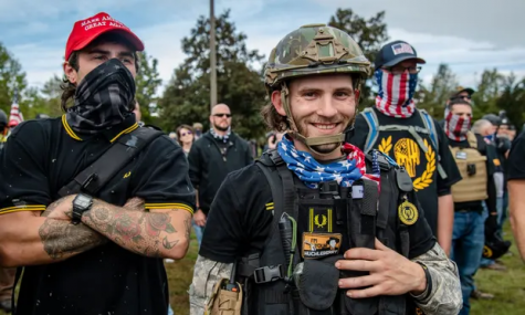A group of Proud Boys wearing tactical gear and their signature black and yellow Fred Perry polo shirts (Photo from The Guardian).