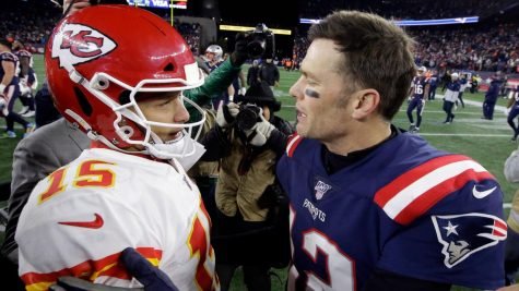 Chiefs quarterback Patrick Mahomes, left, and then-Patriots quarterback Tom Brady speak at midfield after a 2019 game in Foxborough, Mass. Picture from the Tampa Bay Times taken by STEVEN SENNE | AP