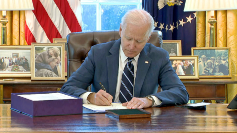 President Joe Biden signs the 1.9 trillion dollar COVID relief bill into law (CNN)