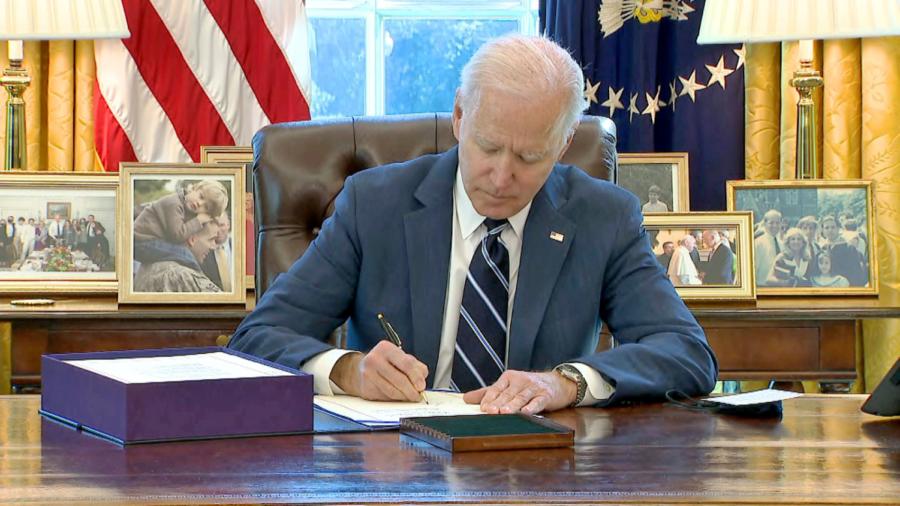 President Joe Biden signs the 1.9 trillion dollar COVID relief bill into law (CNN)